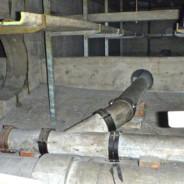 Ausbau asbesthaltiger Rohrleitungen und Trassen in einer Hohldecke eines Bahnhofs